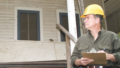 Home Inspector in front of home
